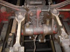 Rocker arm assembly from top of cylinder block showing forged arm assembly